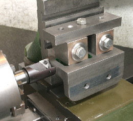 Milling on the lathe using a vertical slide.
